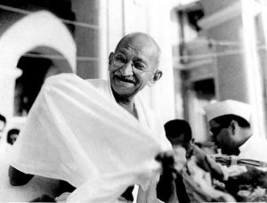 Mahatma_Gandhi_laughing.jpeg-615x467